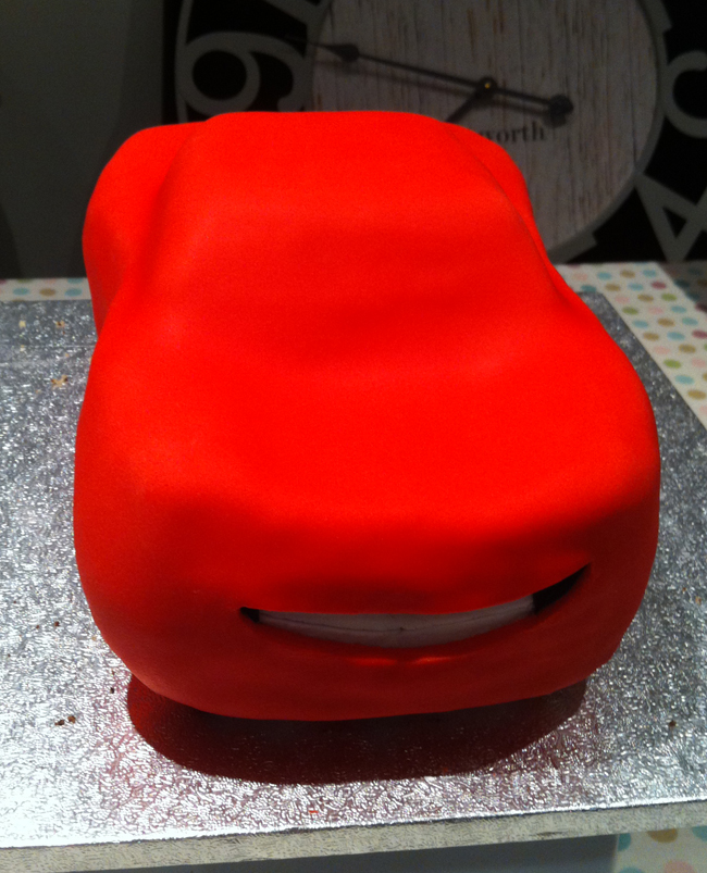 After covering with red fondant, and revealing his smile!